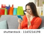 worried lady buying online with ... | Shutterstock . vector #1165216198