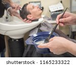 a man paints his hair in a... | Shutterstock . vector #1165233322