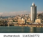 Haifa is city in Israel. It is situated on Israeli Mediterranean Coastal Plain, mouth of Kishon River and on northern slopes of Mount Carmel and around Haifa Bay. View on Downtown Haifa  and port.