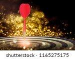 target dart with arrow over... | Shutterstock . vector #1165275175