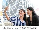 happy asian girls selfie with... | Shutterstock . vector #1165275625
