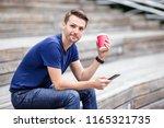 caucasian man is reading text...   Shutterstock . vector #1165321735