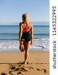 fit woman doing leg stretching...   Shutterstock . vector #1165322995