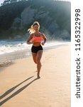 blonde fitness woman running at ...   Shutterstock . vector #1165322998