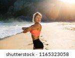 fit woman doing shoulder...   Shutterstock . vector #1165323058