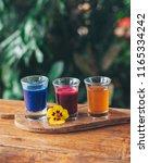 healthy shot drinks | Shutterstock . vector #1165334242