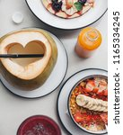 smoothie bowl served with... | Shutterstock . vector #1165334245
