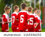 boys football team together.... | Shutterstock . vector #1165336252