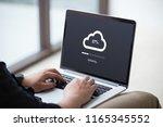 man doing cloud uploading on... | Shutterstock . vector #1165345552