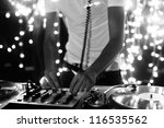 a cool male dj on the turntables | Shutterstock . vector #116535562
