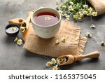 cup of delicious camomile tea... | Shutterstock . vector #1165375045