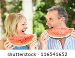 senior couple enjoying slices... | Shutterstock . vector #116541652