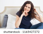 beautiful middle age woman... | Shutterstock . vector #1165427272