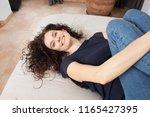 overhead portrait of beautiful... | Shutterstock . vector #1165427395