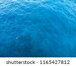 one buoy and sea marker in... | Shutterstock . vector #1165427812