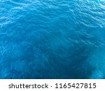 deep blue and green sea surface ... | Shutterstock . vector #1165427815
