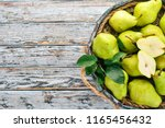 assortment of pears in a wooden ... | Shutterstock . vector #1165456432