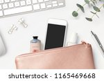 smartphone mock up with rose... | Shutterstock . vector #1165469668