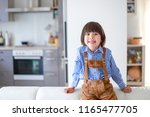 toddler boy with lederhosen... | Shutterstock . vector #1165477705