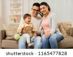 family  parenthood and people... | Shutterstock . vector #1165477828
