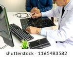 Stock photo professional brain doctor give a counselor to the patient and tell the detail to help for good 1165483582