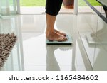 old woman standing on weight... | Shutterstock . vector #1165484602