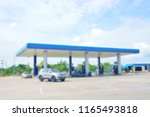 blurred petrol station with... | Shutterstock . vector #1165493818