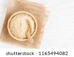 brown sugar and wood spoon in...   Shutterstock . vector #1165494082
