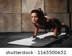 strong young woman doing push... | Shutterstock . vector #1165500652