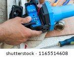 man repairs water pressure... | Shutterstock . vector #1165514608