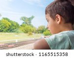 boy 5 years old with interest... | Shutterstock . vector #1165515358