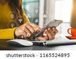woman using smart phone for... | Shutterstock . vector #1165524895