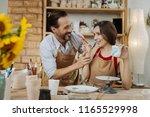 fun in workshop. dark haired... | Shutterstock . vector #1165529998