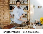 new workshop. bearded dark... | Shutterstock . vector #1165531858