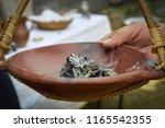 smoking herbs in an earthenware ... | Shutterstock . vector #1165542355