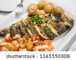 traditional portuguese grilled... | Shutterstock . vector #1165550308