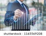 businessman draws a graph of... | Shutterstock . vector #1165569208