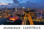 skyline of singapore with... | Shutterstock . vector #1165578115