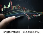 charts of stock market... | Shutterstock . vector #1165586542