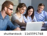 serious millennial... | Shutterstock . vector #1165591768
