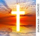 cross appearing on sunrise sky