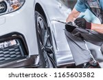 Used Car Maintenance. Auto Service Worker Preparing Vehicle For Scheduled Service. - stock photo