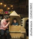 parenthood concept. boy play...   Shutterstock . vector #1165615852