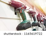 electric screwdriver for... | Shutterstock . vector #1165619722