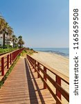 wooden path on the beach. mijas ... | Shutterstock . vector #1165659508
