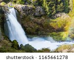 truful truful waterfall at... | Shutterstock . vector #1165661278