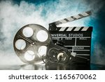 vintage film claper with film... | Shutterstock . vector #1165670062