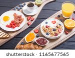 breakfast with yogurt  eggs ... | Shutterstock . vector #1165677565
