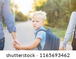 father and older brother... | Shutterstock . vector #1165693462