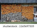 wood pile in countryside   Shutterstock . vector #1165697335